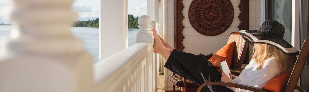 A woman relaxing on te balcony