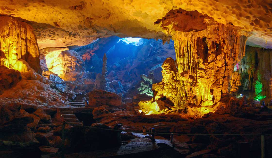 Colourfully lit large cave