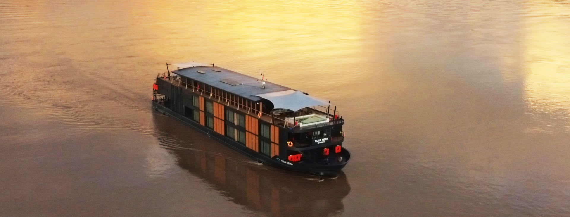 Ship on the Amazon river at sunset