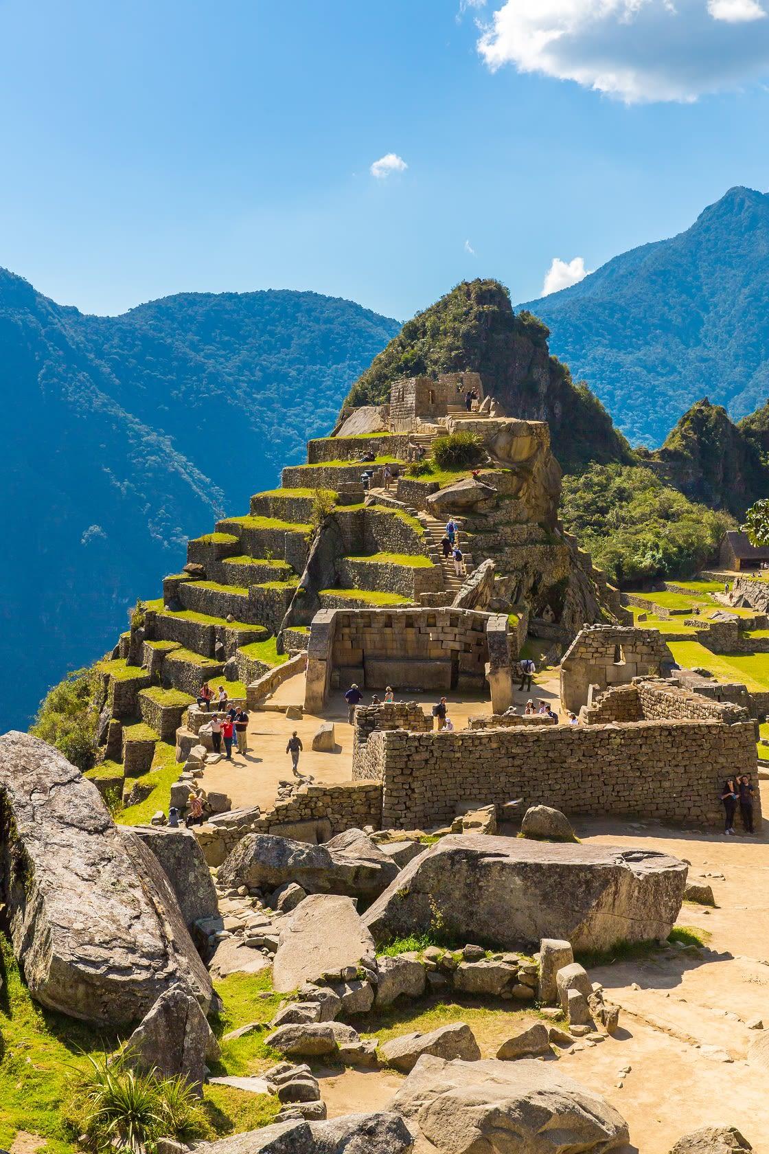 Tourists Visiting The Sacred Plaza at Machu Picchu, Peru