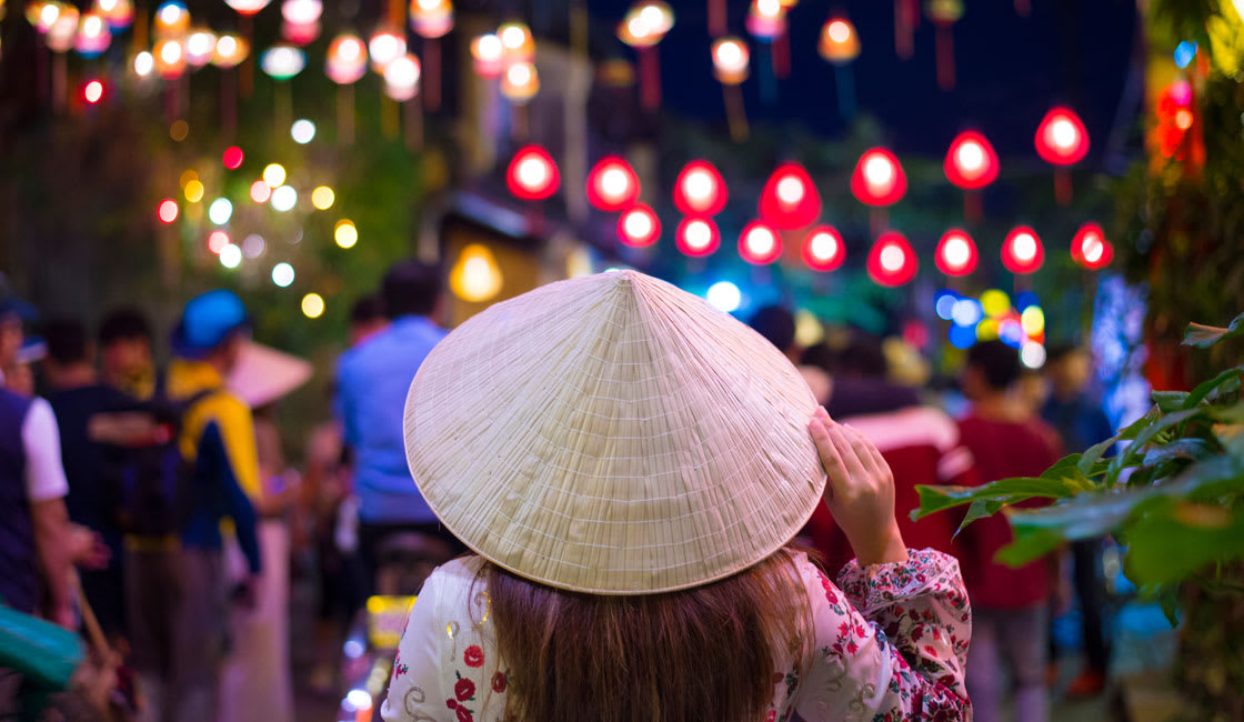 lady wearing a typical hat in a festival