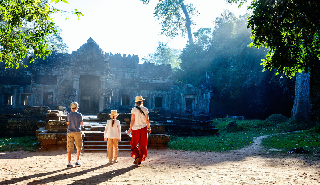 family visiting a temple in cambodia