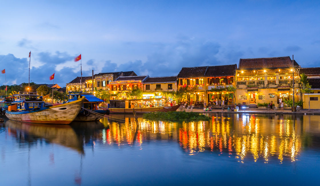 River in Hoi An and reflections of buildings in the evening