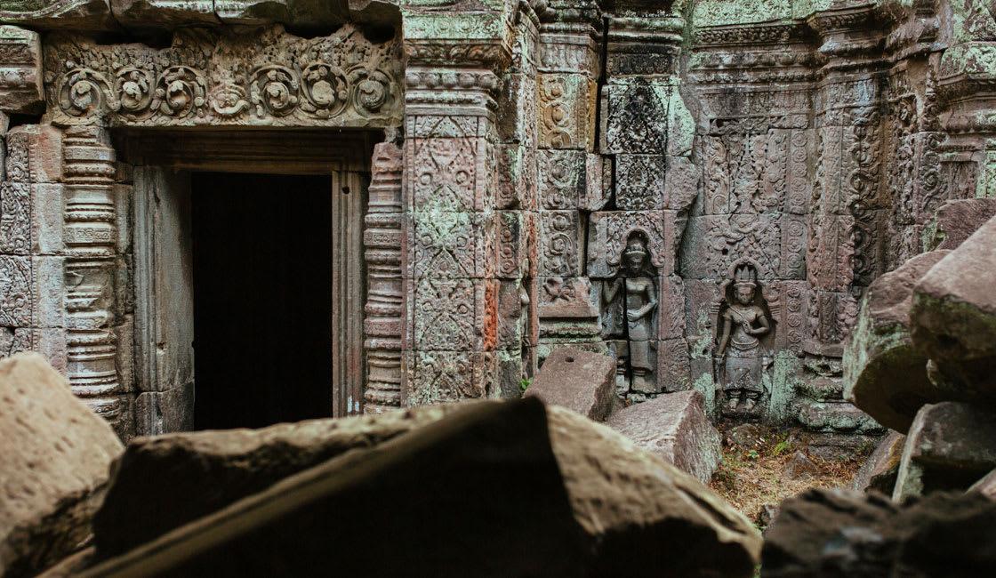 Carvings visible among ruins