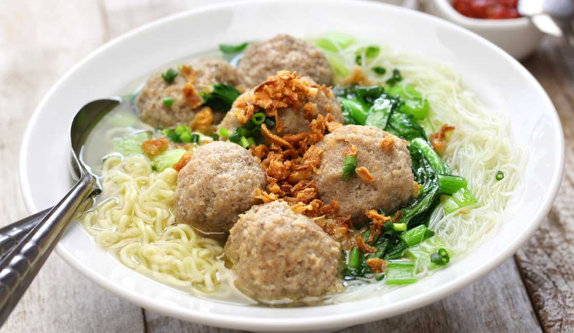 A soup with meatballs