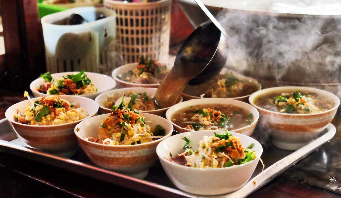 Soup poured into small bowls on a street stall
