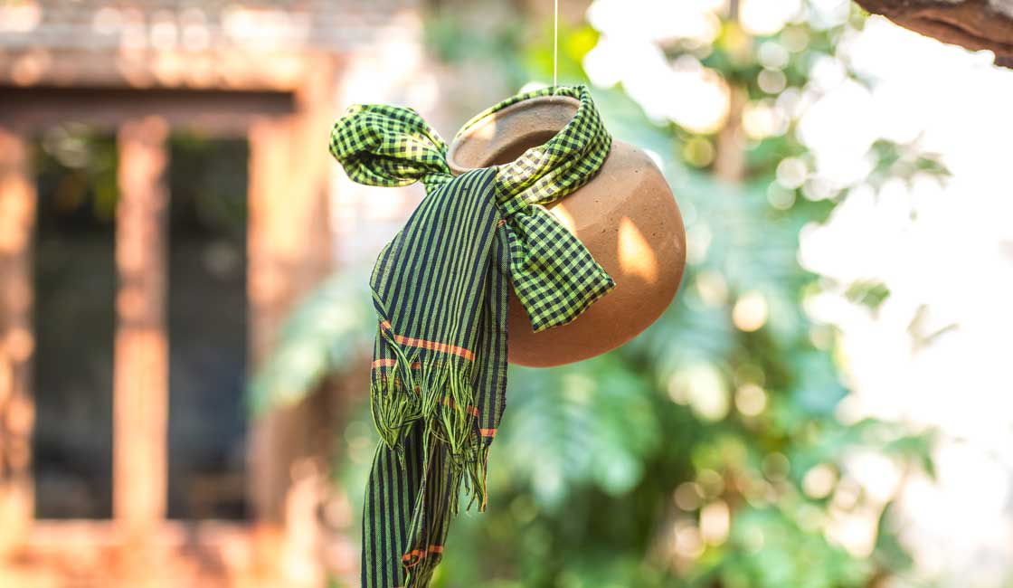Scarf wrapped around a pot and hung up as a decoration