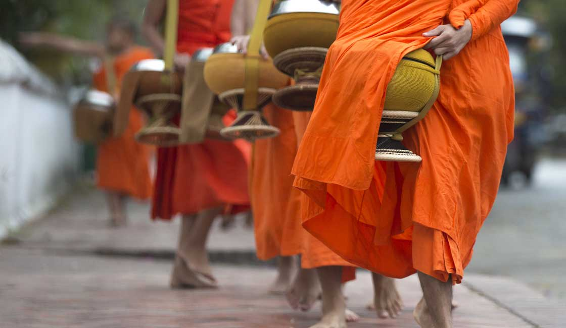 Line of orange-robed monks