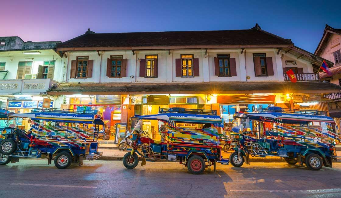 Colonial building and tuk-tuks in Luang Prabang