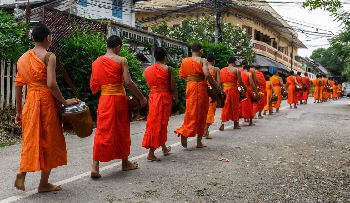 Monks walking from the Alms Giving ceremony