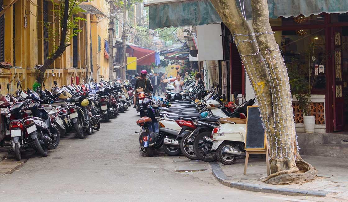 Motorbikes parked on the sidewalk