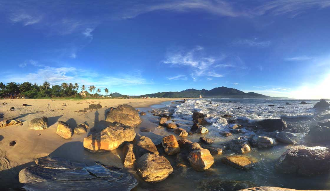 The wide-angle shot of a beach