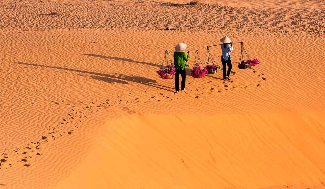 People walking on the sand dunes