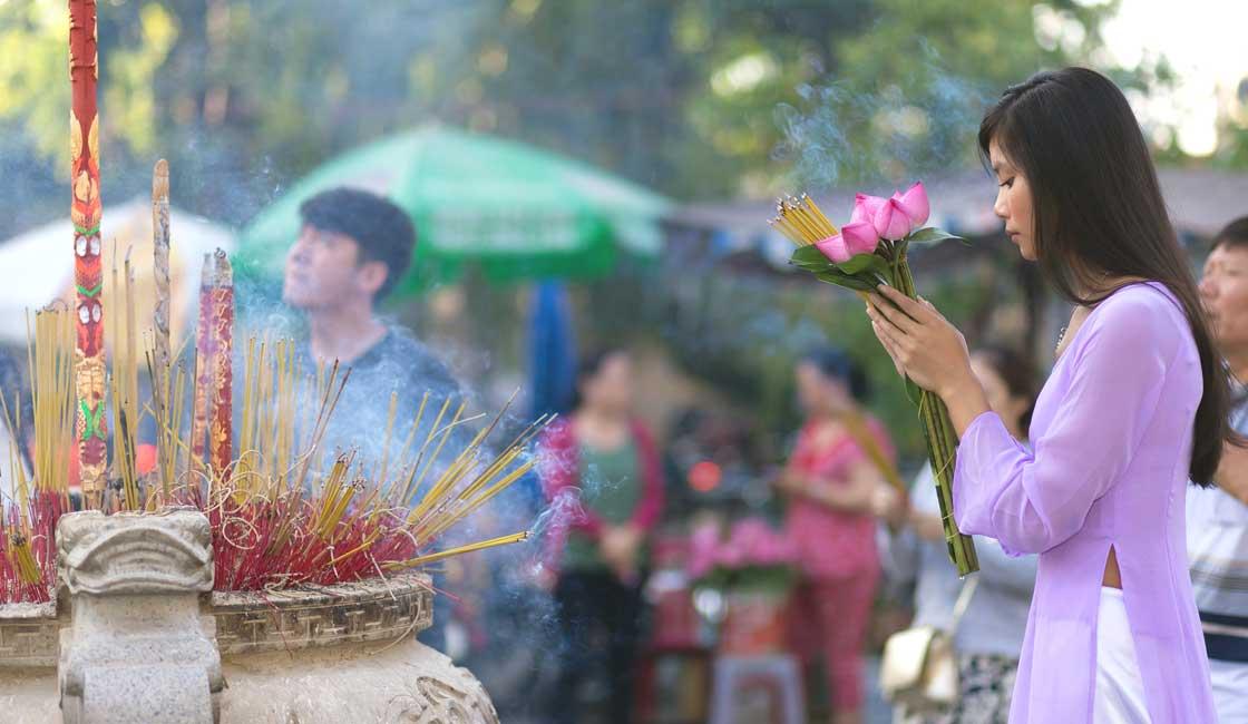A girl burning incense