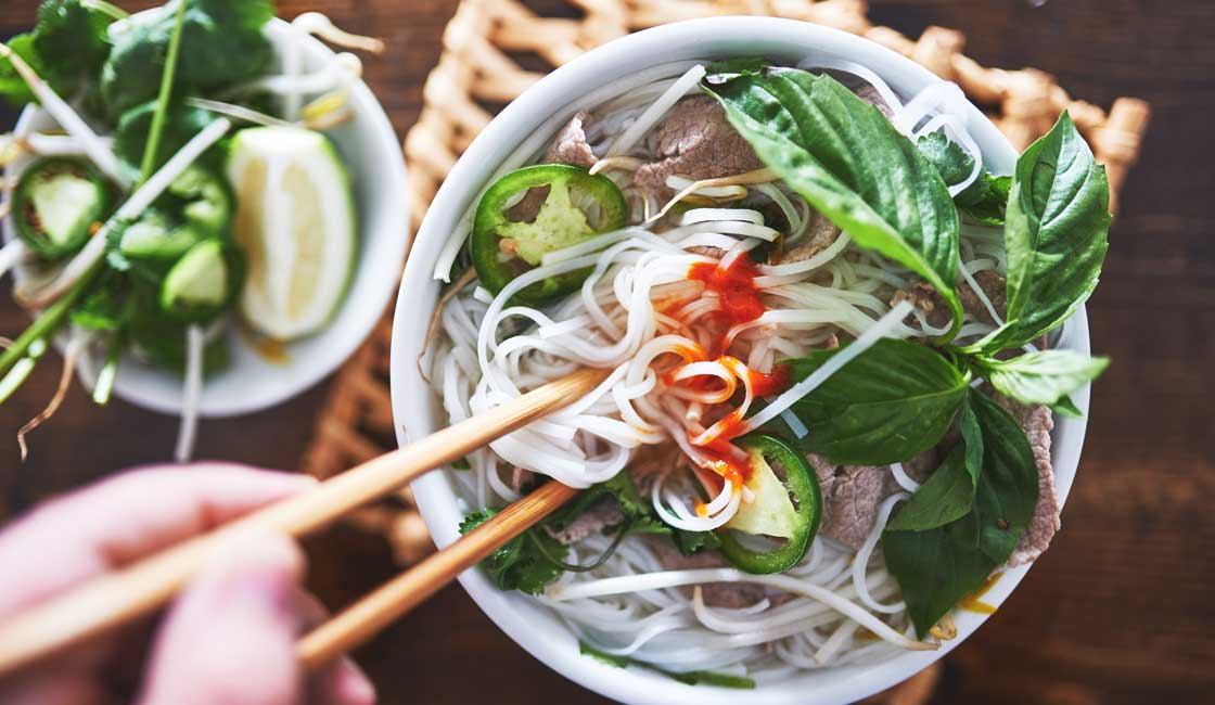 Bowl of noodle soup with chopsticks
