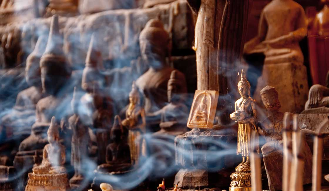Incense lit among the statues