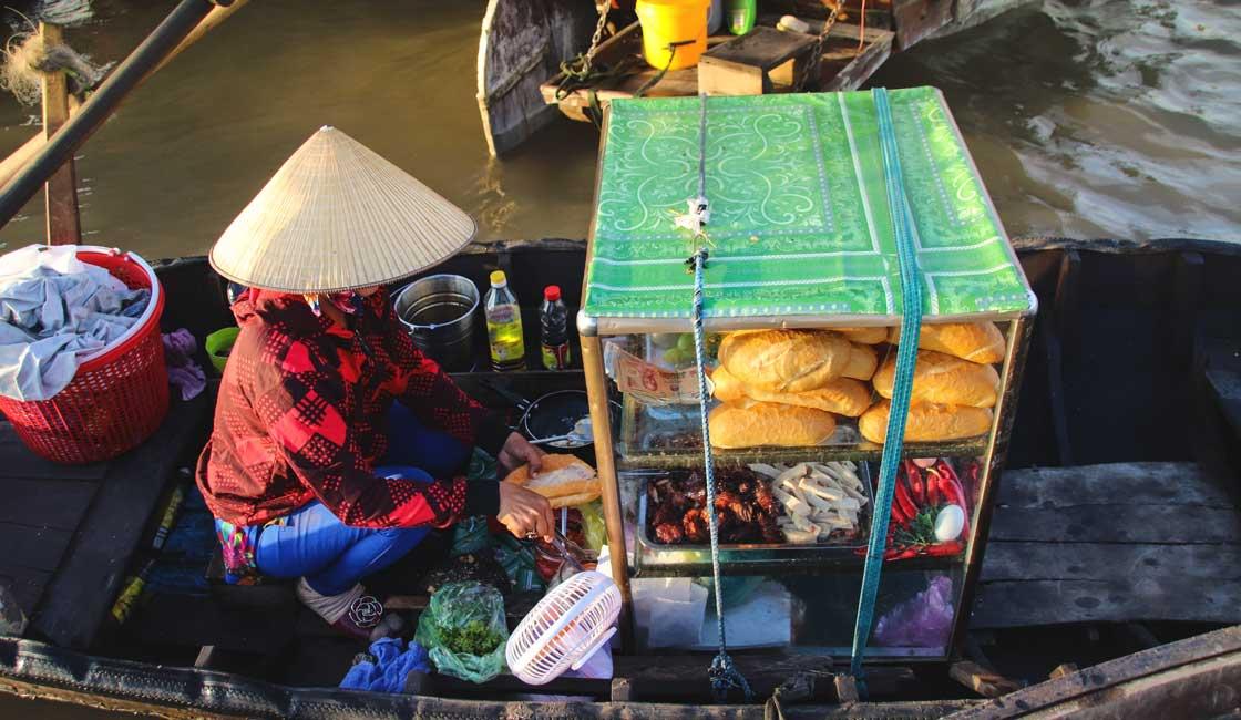 Baguette vendor in the floating market