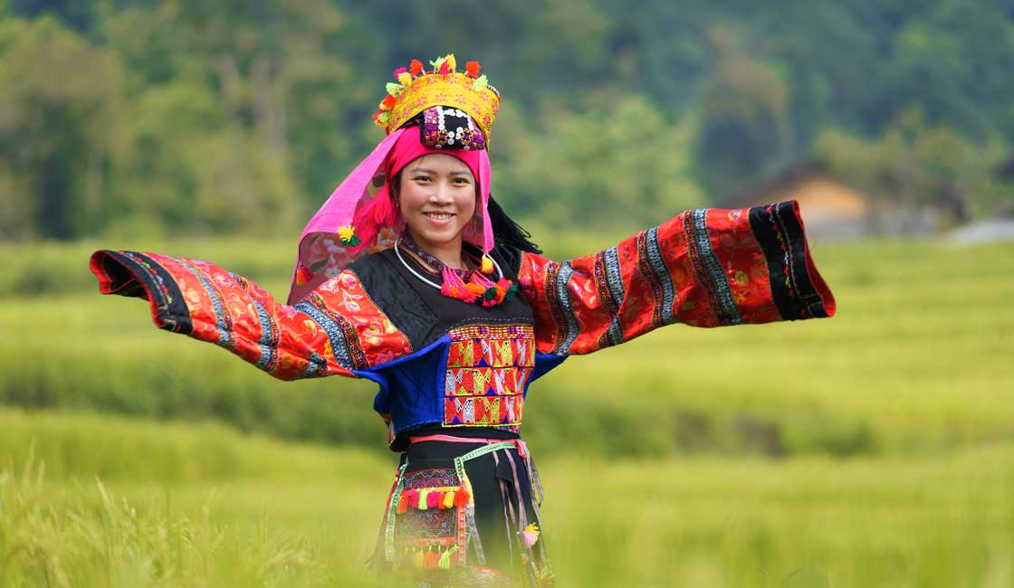 Young smiling girl in the ethnic clothes
