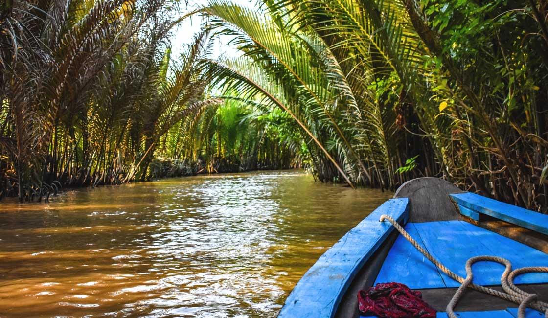 Sampan in the tropical canal
