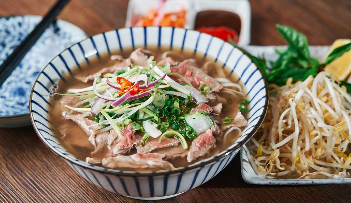 Beef and noodles soup in a bowl