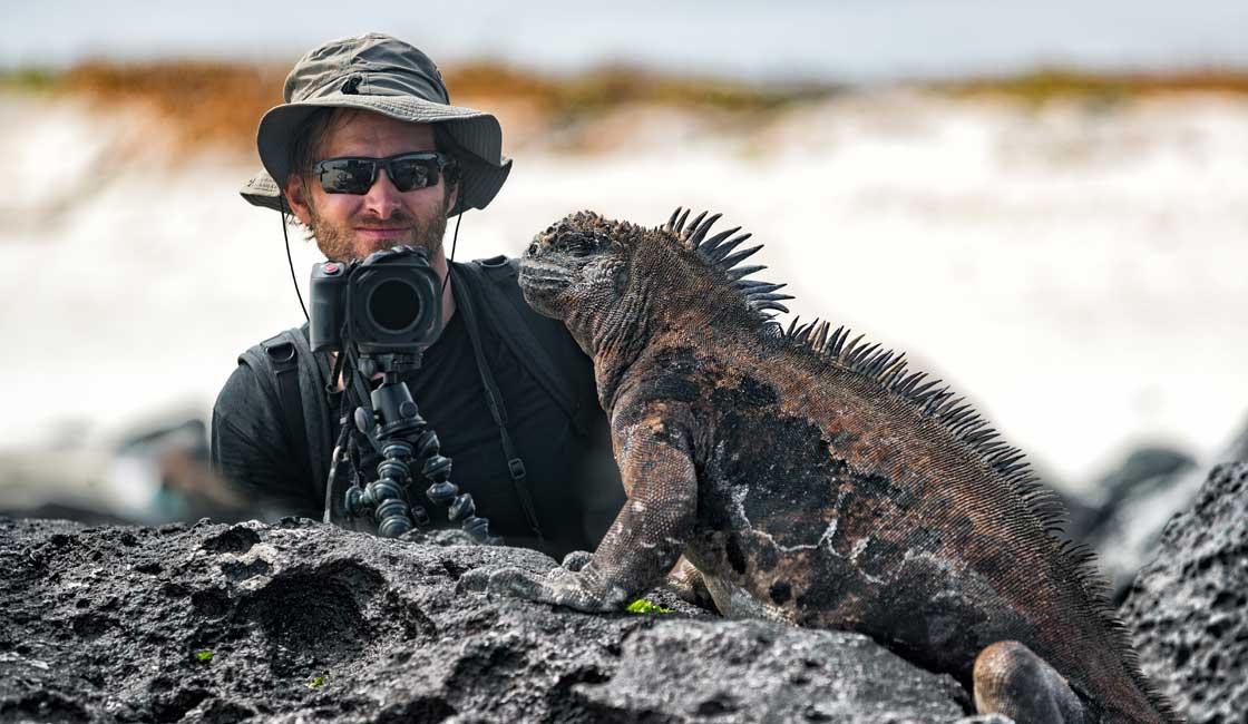 Photographer in front of Marine Iguana