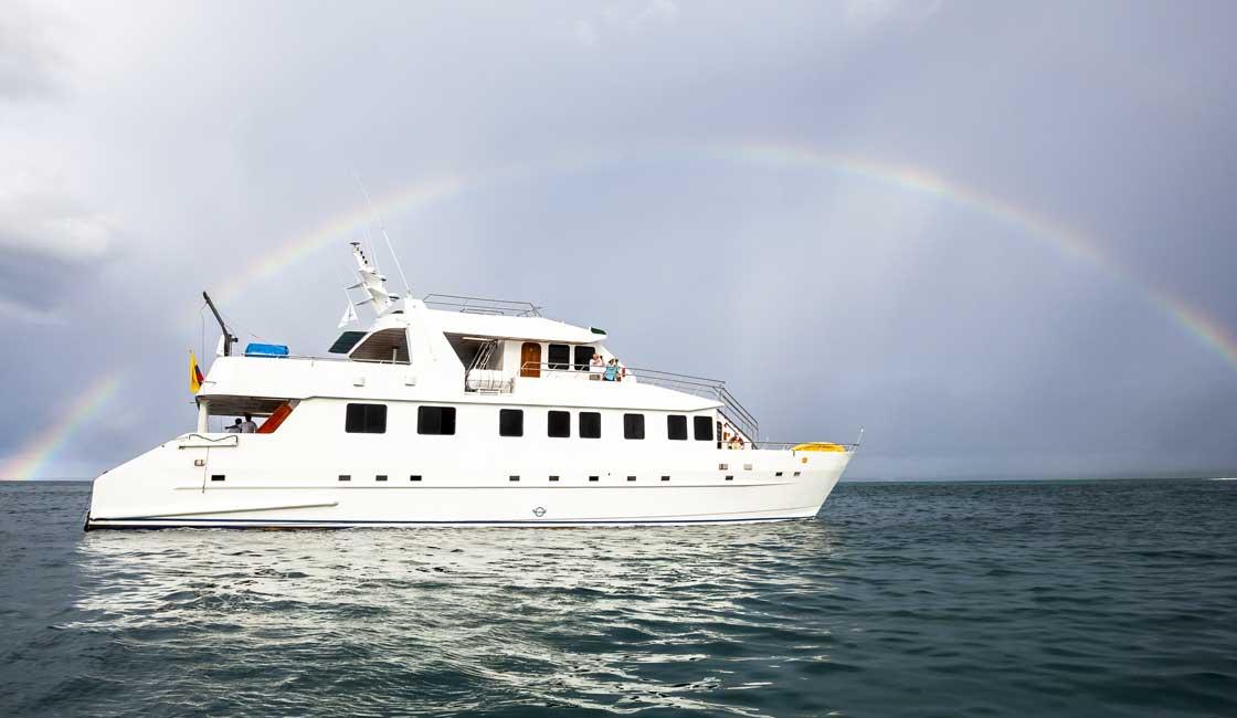 Ship at sea and a rainbow