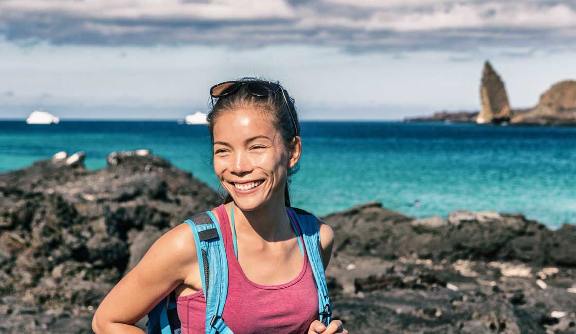 GIrl with a small backpack in Galapagps