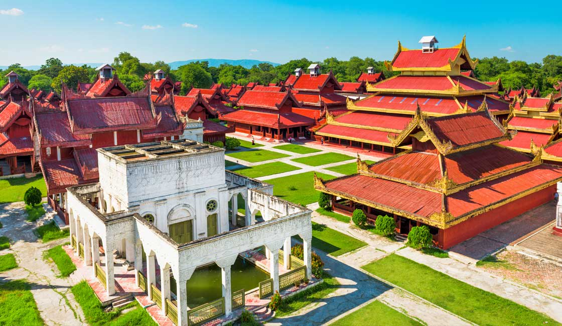 Aerial view of red-roofed palace in Mandalay