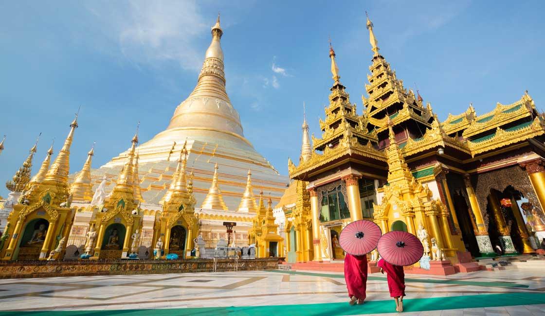 Monks walking through the Shwedagon pagoda
