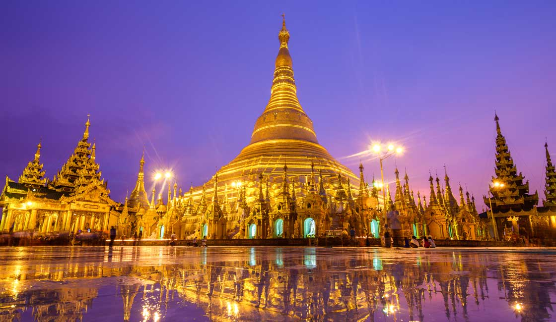Shwedagon pagoda in a purple sunset light