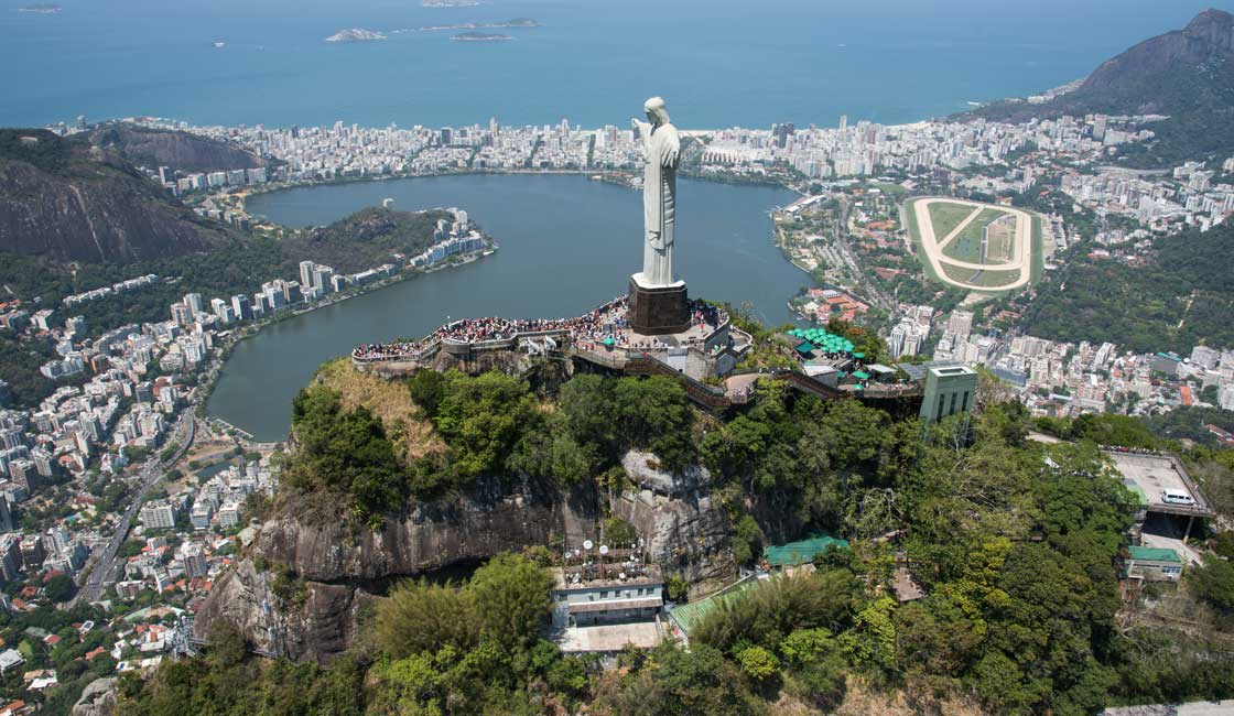 Large statue of Jesus towering on a hilltop