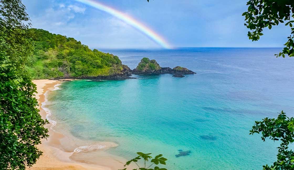 Rainbow over the tropical bay