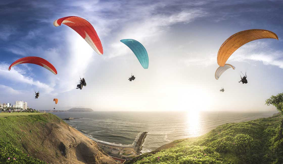 Paragliders over a beach