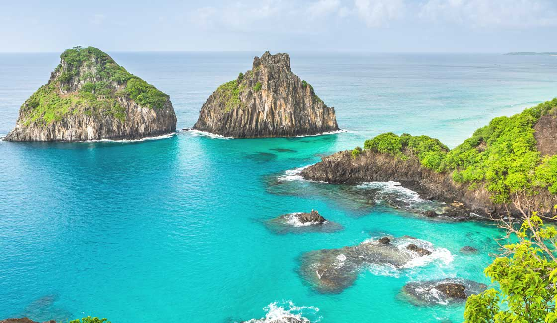 Karst formations over turquoise water