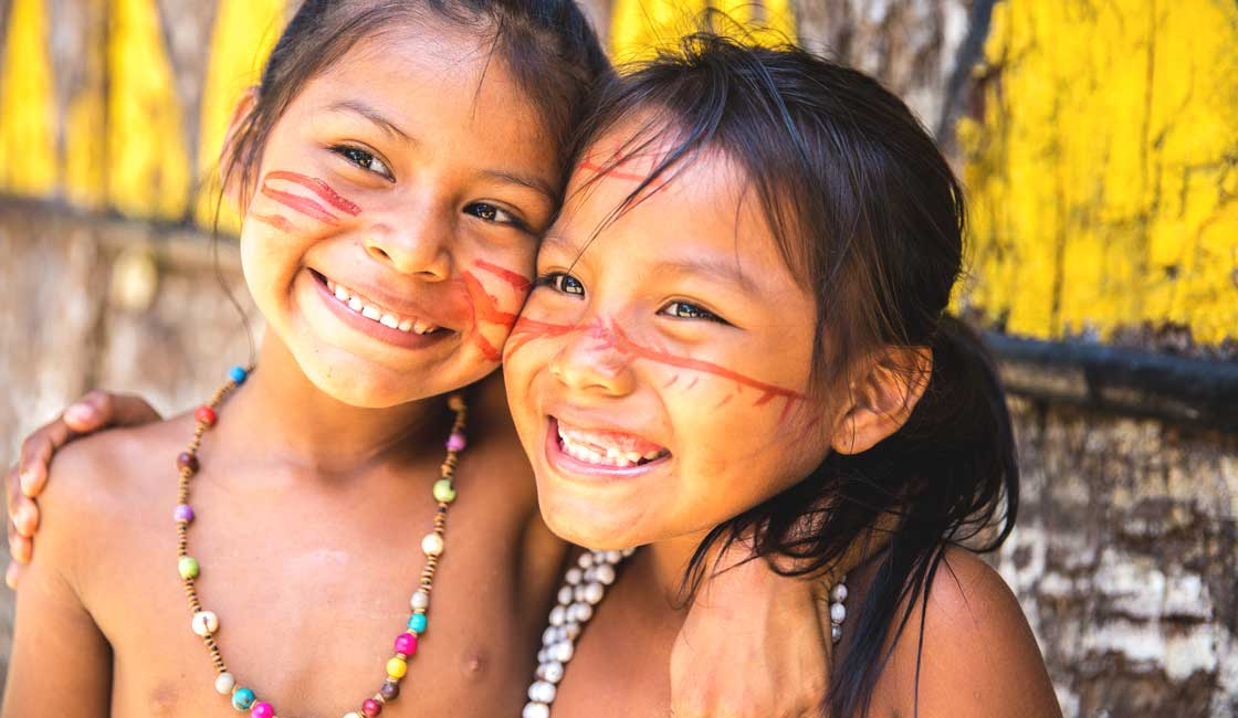 Young native Amazonas girls with traditional face paintings