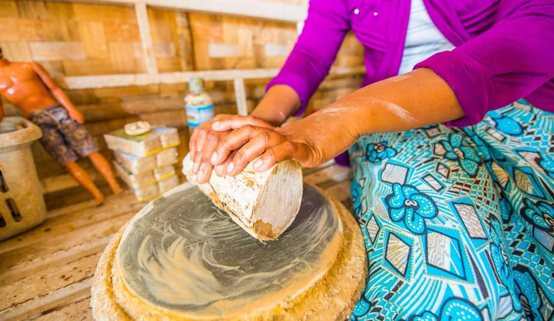 Woman preparing Thanaka paste