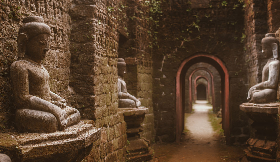 Corridor in a temple with Buddha statues by the walls