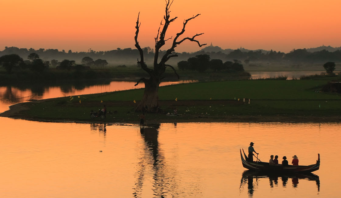Single boat on the river at sunset