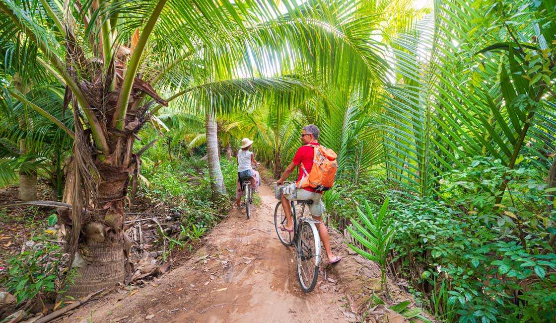 Couple on bicycles in the Mekong Delta