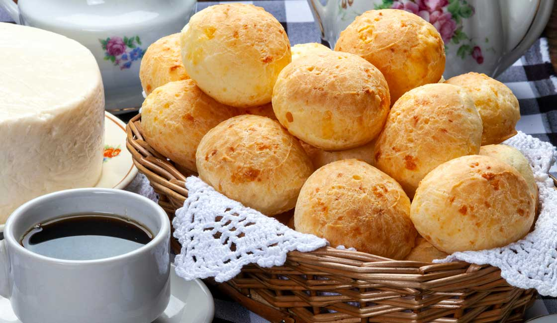 Small bread rolls set on a table with coffee