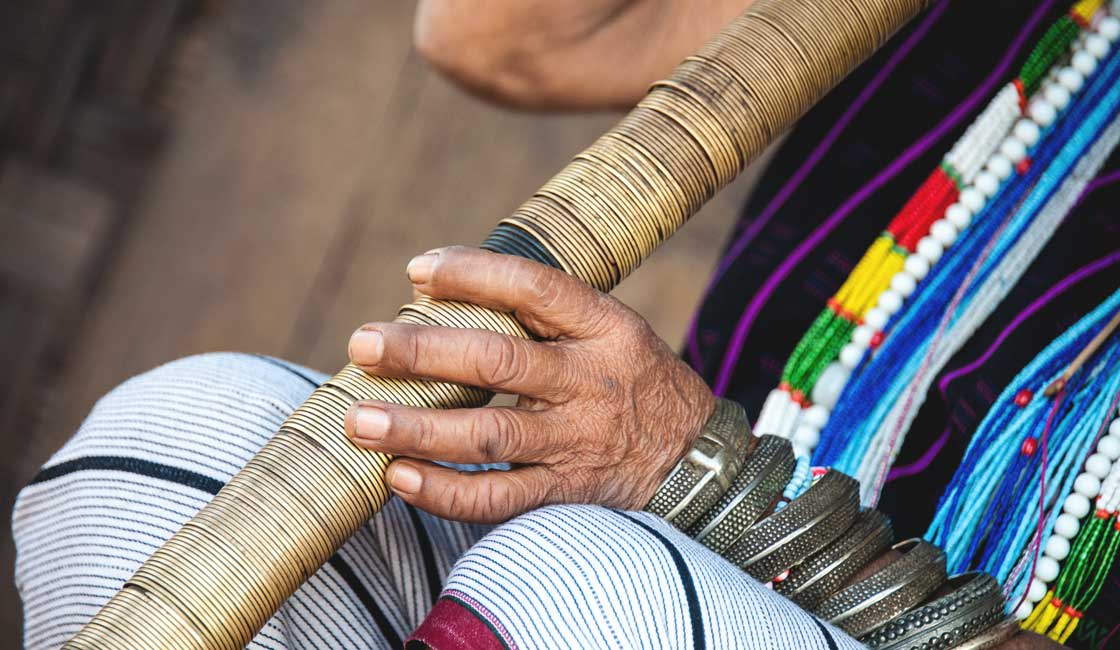 Hands holding a traditional pipes