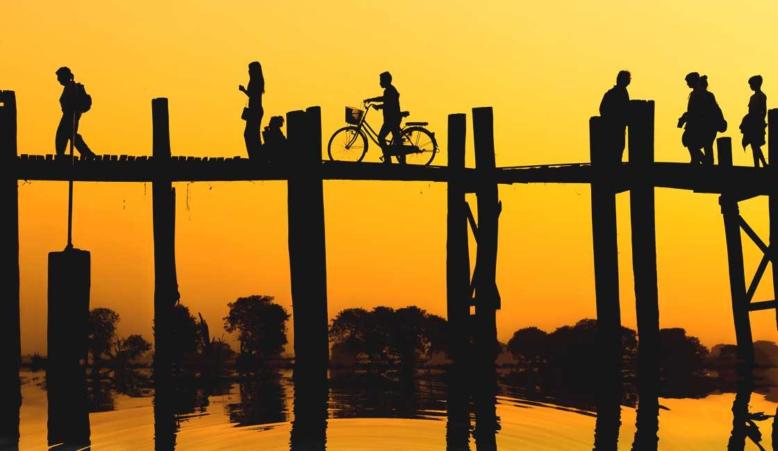People walking on the bridge silhouettes