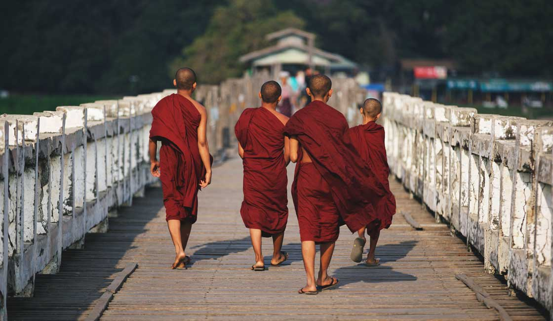 Monks walking the bridge