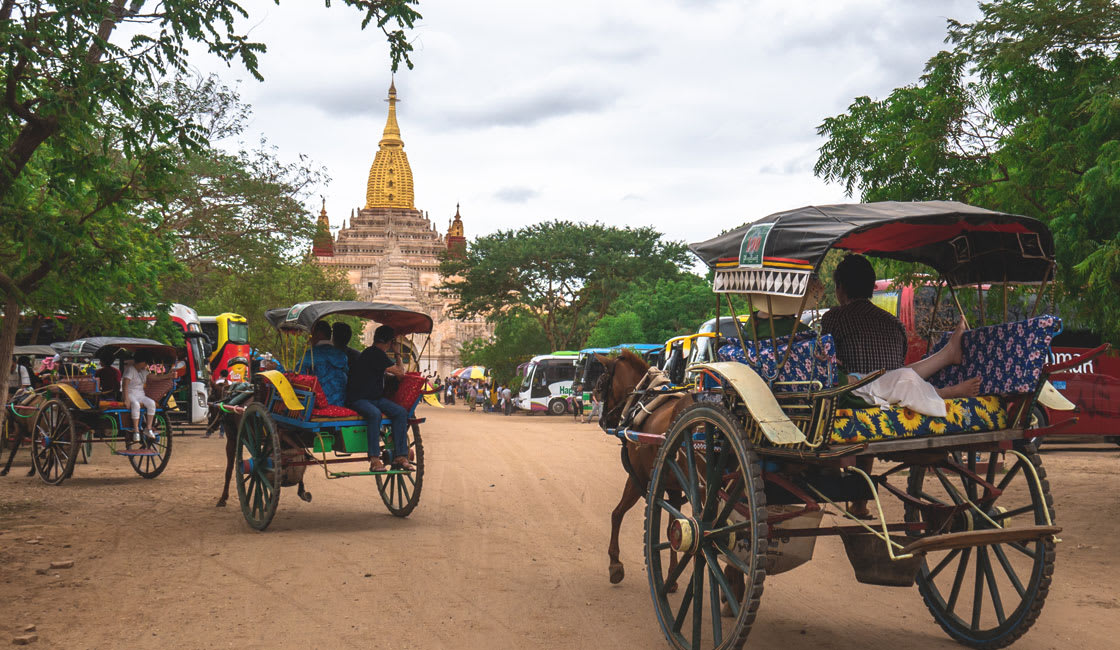 Horse carts in front of a temple
