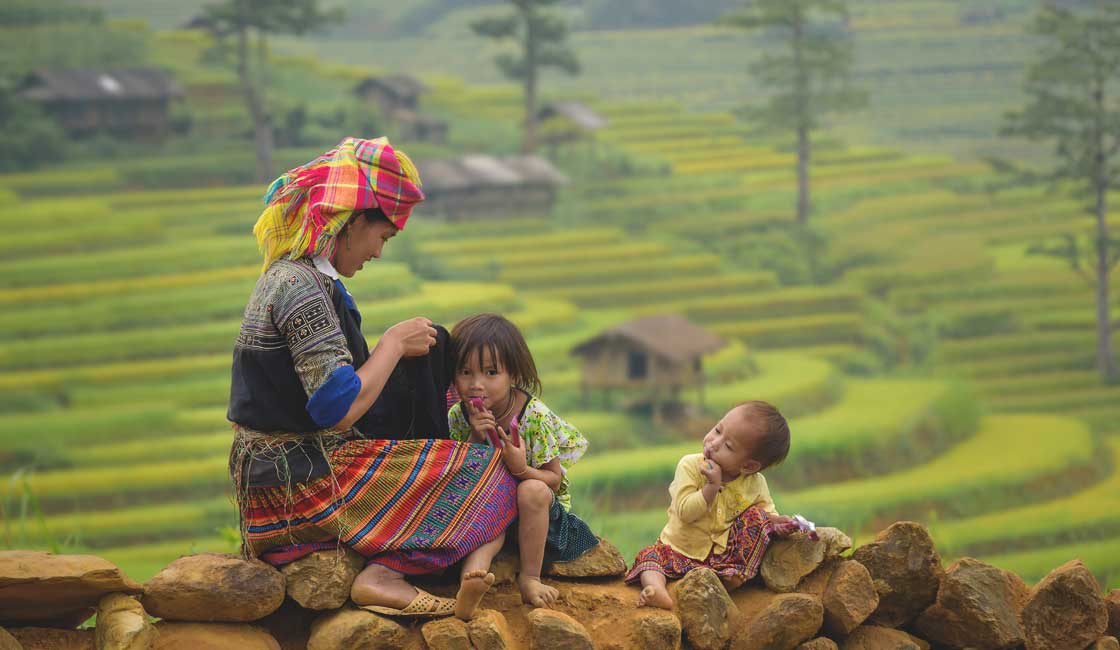 Ethnic family with Sapa hills in the background