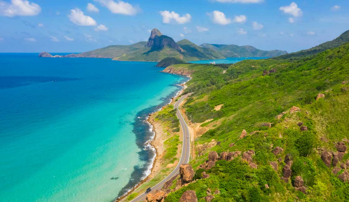 Turquoise sea and green island of Con Dao