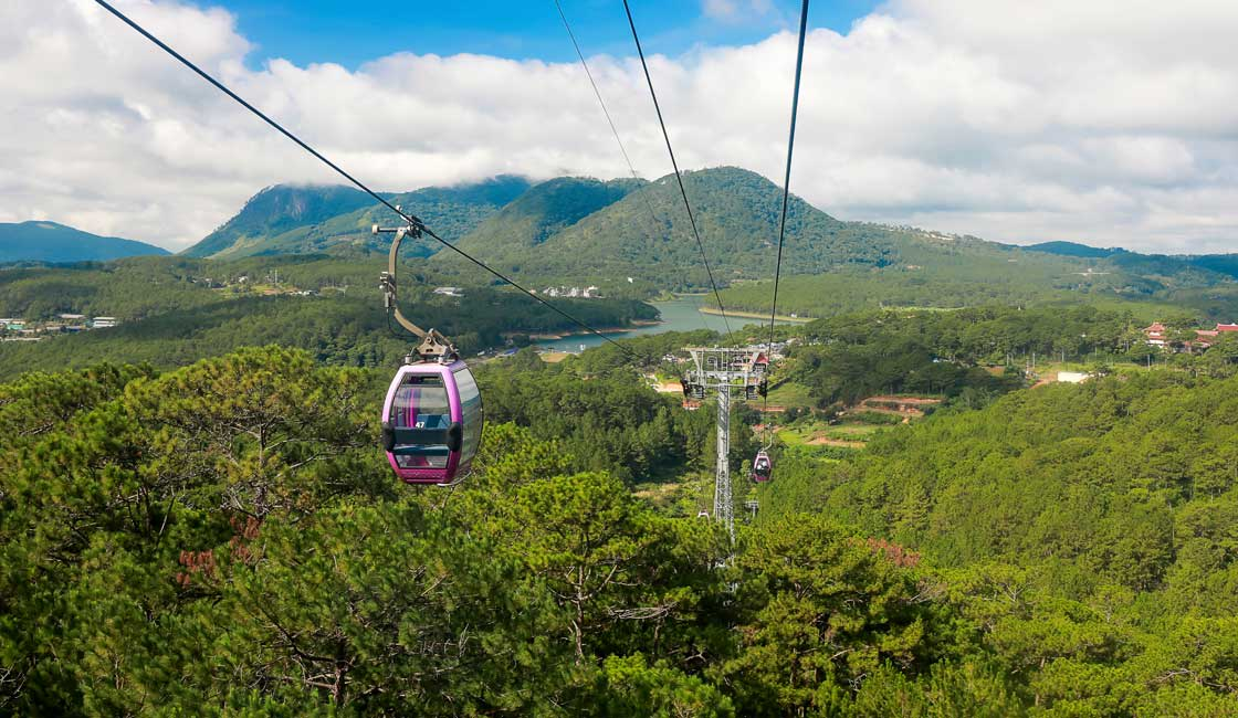 Cable car over green hills