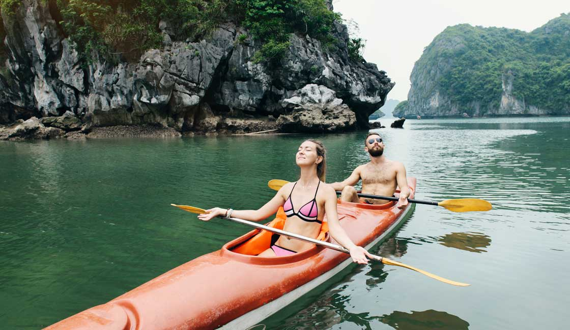 Couple in a kayak in Halong Bay
