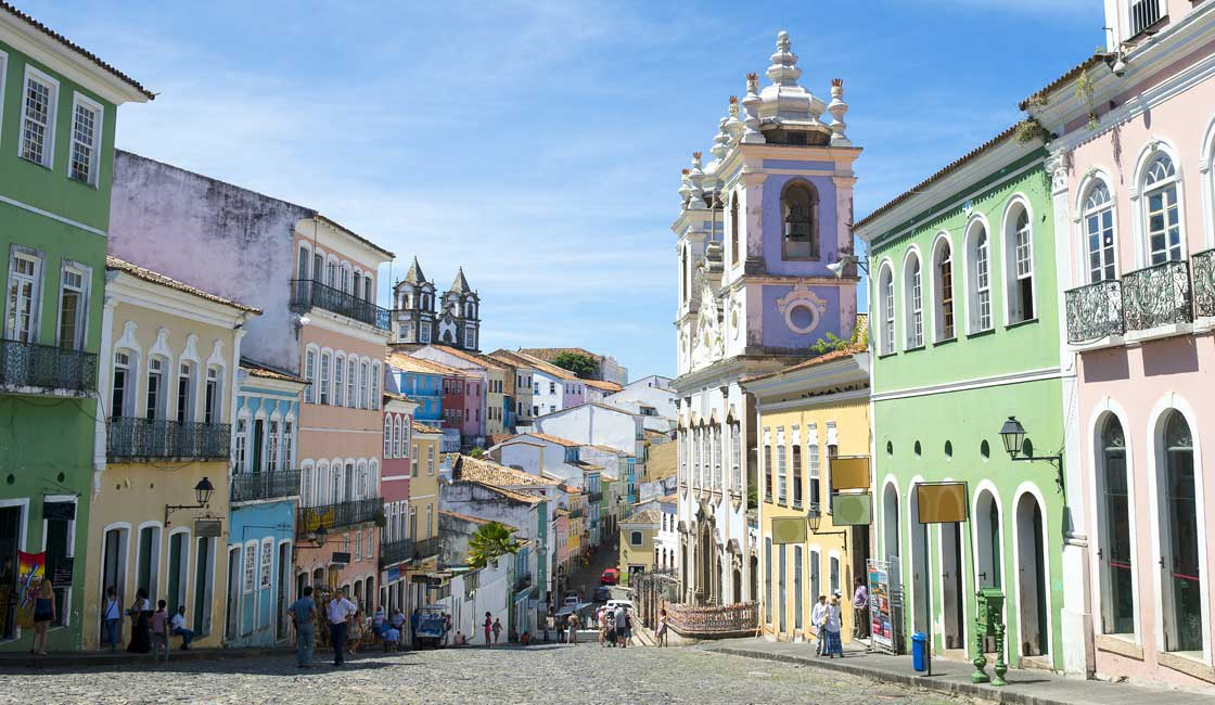 Colorful buildings along the cobblestone street