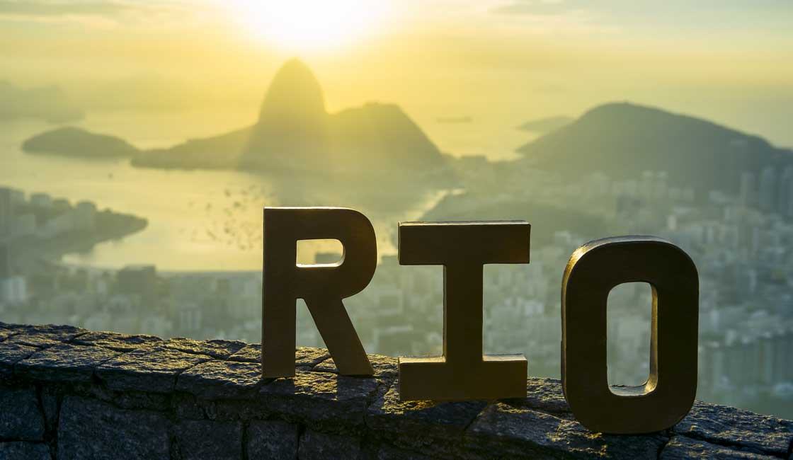 Letters forming the word Rio on the hill overlooking RIo de Janeiro